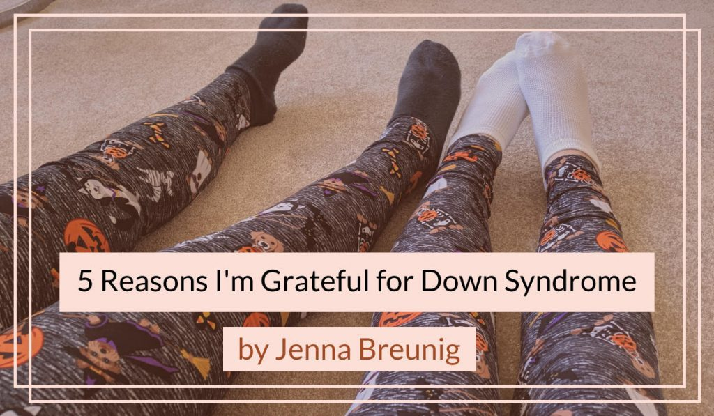 Katie, a girl with Down syndrome, and her sister Jenna wearing matching leggings that have pictures of dogs in Halloween costumes